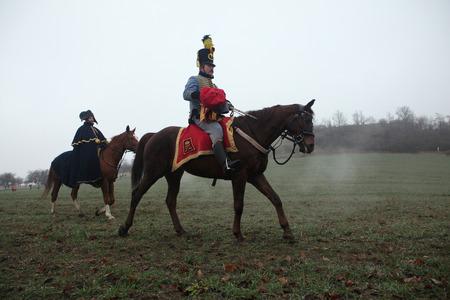 reenactment re enactment: TVAROZNA, CZECH REPUBLIC ? DECEMBER 3, 2011: Re-enactors uniformed as Austrian cavalry attend the re-enactment of the Battle of Austerlitz (1805) near Tvarozna, Czech Republic.