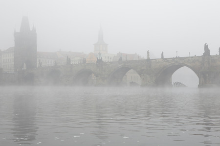 charles bridge: Morning fog over the Charles Bridge in Prague, Czech Republic.