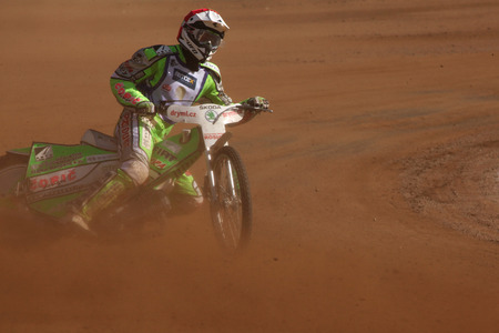 PARDUBICE, CZECH REPUBLIC - OCTOBER 14, 2012: Speedway rider competes on track during the Golden Helmet Prix in Pardubice, Czech Republic.