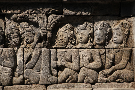 bas: Ascetic men. Stone bas relief from the Borobudur Temle in Central Java, Indonesia.