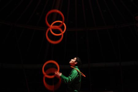 rehearse: PRAGUE CZECH REPUBLIC  NOVEMBER 20 2011: Czech juggler Michal Bados rehearses in the Humberto Circus in Prague Czech Republic.