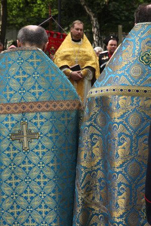 liturgical: PRAGUE CZECH REPUBLIC  MAY 28 2012: Orthodox priests attend the orthodox service in front of the Dormition Church at the Olsany Cemetery in Prague Czech Republic. Editorial