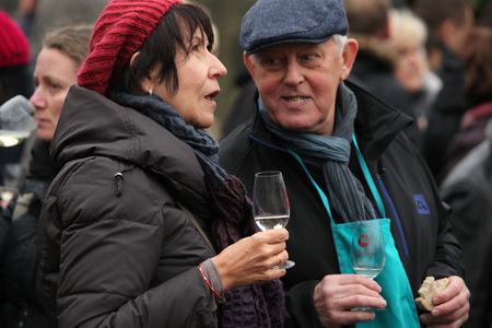 tastes: PRAGUE CZECH REPUBLIC  NOVEMBER 11 2012: Elderly couple tastes young wine during the celebration of Saint Martin Day in Prague Czech Republic.