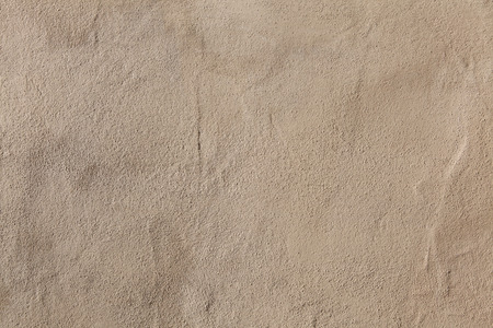 stucco wall: Beige stucco wall. Background texture.