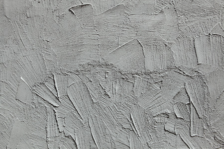 uneven: Grey stucco wall. Background texture.