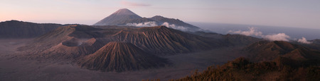 tengger: Sunrise over Mount Bromo (2,329 m) and the Tengger Caldera in East Java, Indonesia. Panorama from Mount Penanjakan (2,770 m). Stock Photo