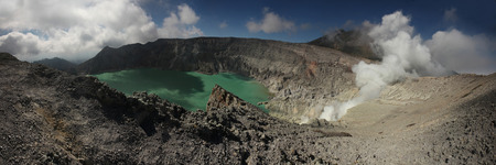 active volcano: Acid lake in the crater of the active volcano of Kawah Ijen in East Java, Indonesia.