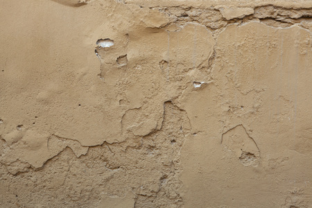 ochre: Old ochre painted stucco wall with cracked plaster. Background texture.