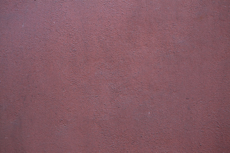 stucco wall: Burgundy red painted stucco wall. Background texture. Stock Photo