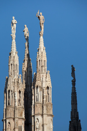 spires: Marble statues of Saints on the spires of the Milan Cathedral (Duomo di Milano) in Milan, Lombardy, Italy.