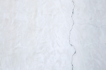 stucco wall: White stucco wall with cracked plaster. Background texture.