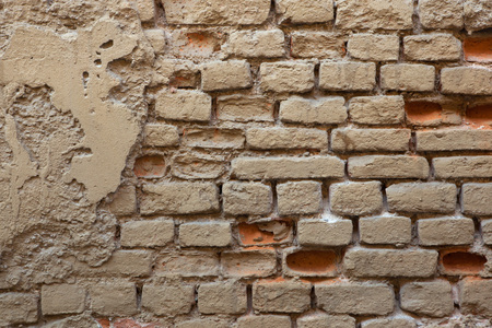 yellow ochre: Old brick ochre painted wall. Background texture. Stock Photo
