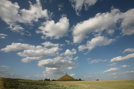 battlefield: Lion Mound over the battlefield of the Battle of Waterloo 1815 near Brussels, Belgium. Stock Photo