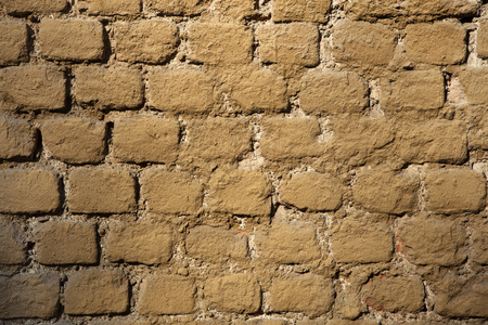 ochre: Old brick ochre painted wall. Background texture. Stock Photo