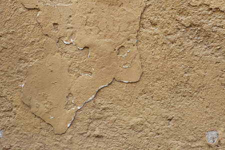 stucco texture: Old ochre painted stucco wall with cracked plaster. Background texture.