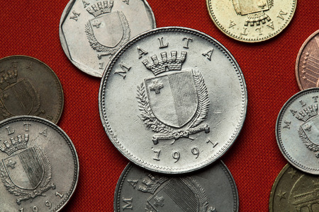 depicted: Coins of Malta. Coat of arms of Malta depicted in the Maltese lira coins.