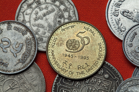 united nations: Coins of Nepal. Nepalese commemorative one rupee coin dedicated to the 50th Anniversary of the United Nations.