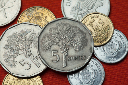 depicted: Coins of the Seychelles. Coconut palm (Cocos nucifera) depicted in the Seychellois five rupee coin. Stock Photo