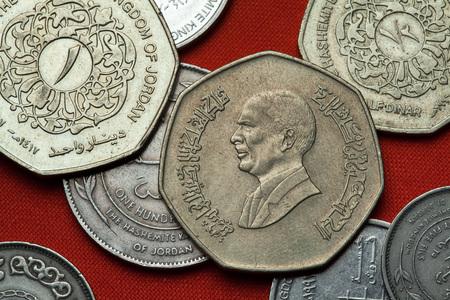 king hussein: Coins of Jordan. King Hussein bin Talal of Jordan depicted in the Jordanian one dinar coin. Stock Photo