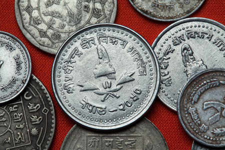 five rupee: Coins of Nepal. Nepalese royal crown depicted in the Nepalese 25 paisa coin. Stock Photo