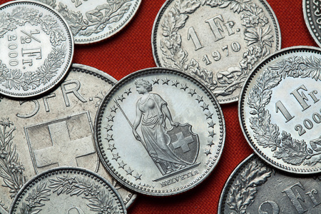 helvetica: Coins of Switzerland. Standing Helvetia depicted in the Swiss one franc coin. Stock Photo