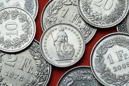 helvetia: Coins of Switzerland. Standing Helvetia depicted in the Swiss half franc coin. Stock Photo