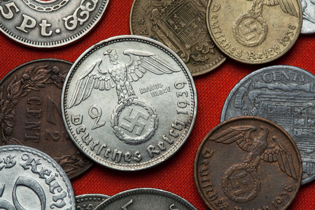 depicted: Coins of Nazi Germany. Nazi eagle atop swastika depicted in the German two Reichsmark coin (1939).