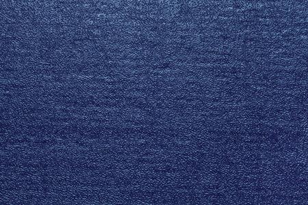 stamped: Dark blue stamped cardboard texture. Blue background.
