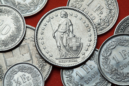 numismatics: Coins of Switzerland. Standing Helvetia depicted in the Swiss two franc coin.
