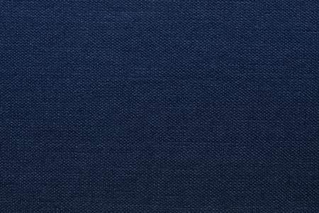 Oscura textura de la lona azul. fondo azul oscuro.