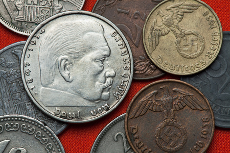 swastika: Coins of Nazi Germany. German President Paul von Hindenburg (1847 - 1934) depicted in the German two Reichsmark coin (1939). Stock Photo