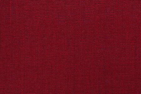 Burgundy red textile texture. Burgundy red background. Standard-Bild