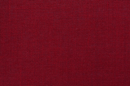 Burgundy red textile texture. Burgundy red background. Banco de Imagens