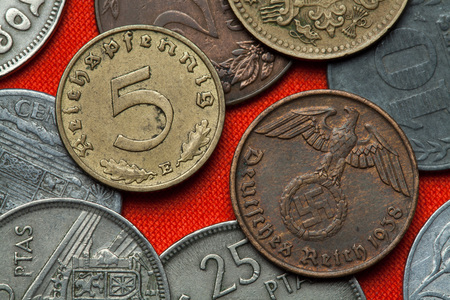 depicted: Coins of Nazi Germany. Nazi eagle atop swastika depicted in the German Reichsmark coins (1938).