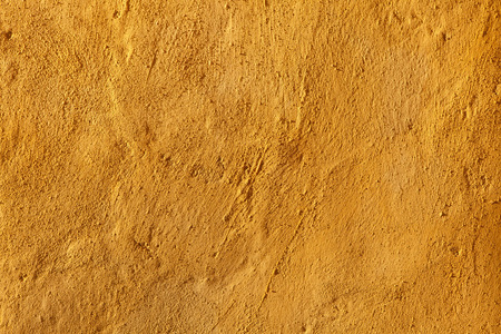stucco wall: Yellow stucco wall. Background texture.