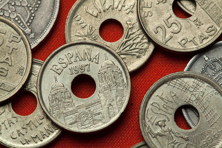 full of holes: Coins of Spain. Palace of the Assembly of the autonomous city of Melilla depicted in the Spanish 25 peseta coin (1997). Stock Photo