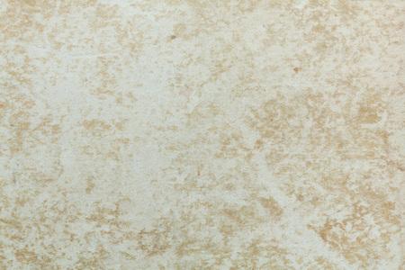 beige: Badly damaged beige cardboard texture. Beige background.