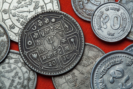 numismatic: Coins of Nepal. Hindu trishul depicted in the Nepalese rupee coins.