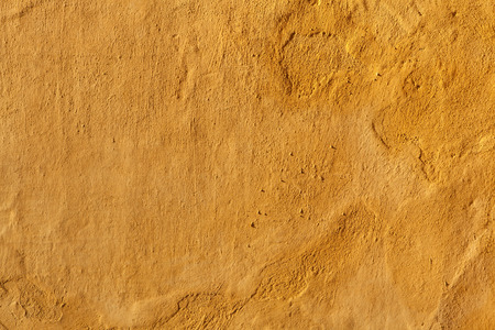 yellow  ochre: Yellow stucco wall. Background texture.