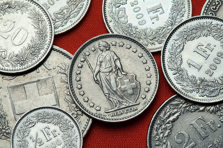 helvetia: Coins of Switzerland. Standing Helvetia depicted in the Swiss one franc coin. Stock Photo