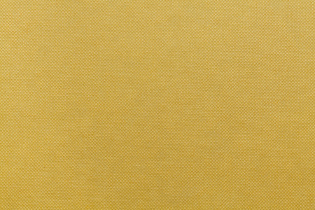 stamped: Yellow stamped cardboard texture. Yellow background.