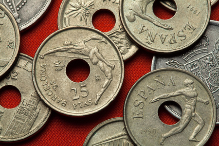 BARCELONA, SPAIN - MARCH 2, 2016: High jumper and discus thrower depicted in the Spanish 25 peseta coin dedicated to the Barcelona 1992 Summer Olympics.