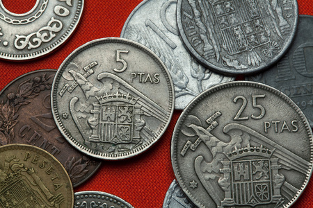 Coins of Spain under Franco. Coat of arms of Spain under Franco depicted in the Spanish five peseta coin (1957). Stock Photo