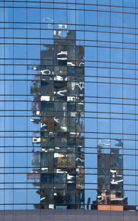 bosco: MILAN, ITALY - NOVEMBER 8, 2015: Reflection of the Bosco Verticale (Vertical Forest) residential towers in the Porta Nuova district in Milan, Lombardy, Italy.