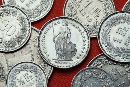 franc: Coins of Switzerland. Standing Helvetia depicted in the Swiss one franc coin. Stock Photo