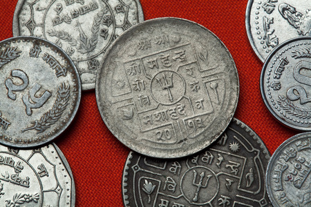 depicted: Coins of Nepal. Hindu trishul depicted in the Nepalese rupee coins.
