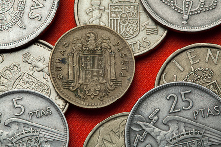 Coins of Spain. Coat of arms of Spain under Franco depicted in the Spanish one peseta coin (1966). Stock Photo