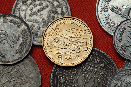 numismatic: Coins of Nepal. Map of Nepal and the Himalayas depicted in the Nepalese one rupee coin.