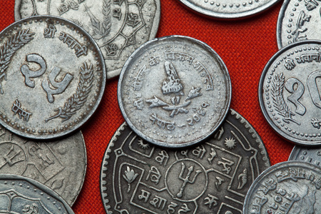 depicted: Coins of Nepal. Nepalese royal crown depicted in the Nepalese five paisa coin. Stock Photo
