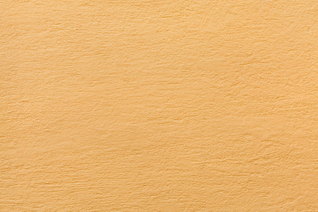 yellow ochre: Yellow ochre painted stucco wall. Background texture.